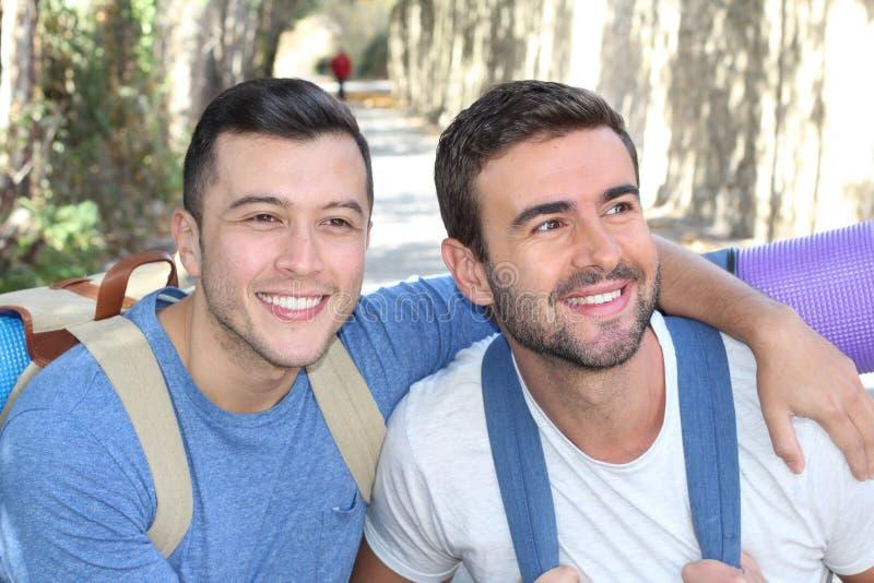 Gay couple enjoying a hike royalty free stock photography