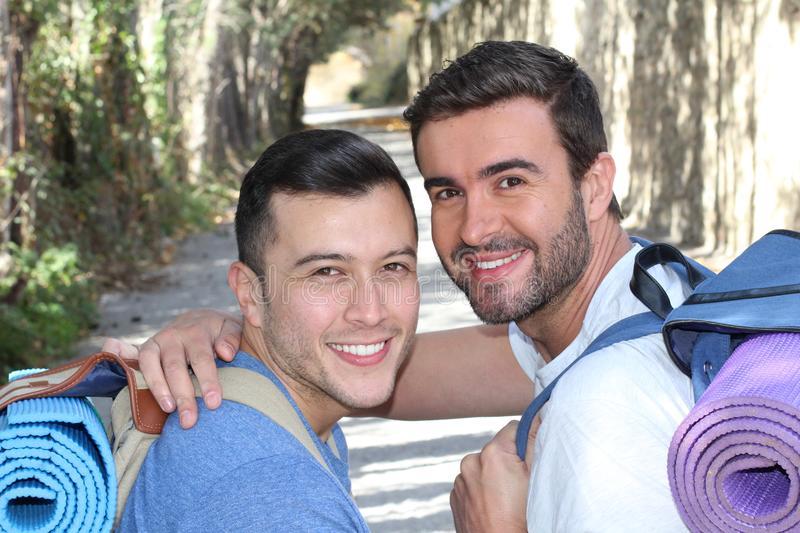 Gay couple enjoying a hike royalty free stock images
