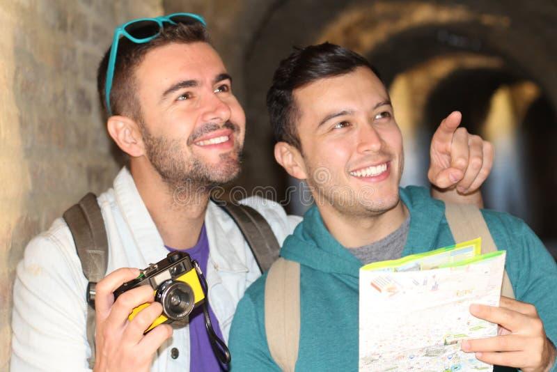 Gay couple enjoying tourism around Europe royalty free stock images