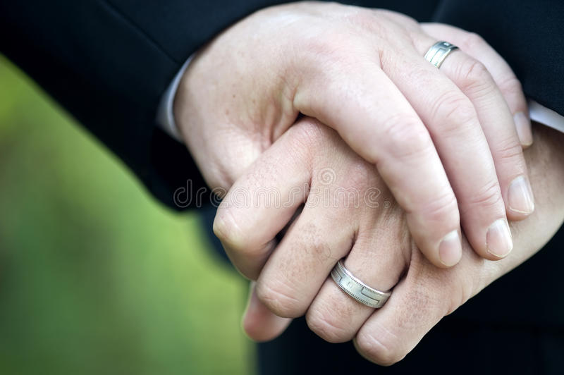 Gay Couple Holding Hands With Wedding Rings Stock Photo Image of