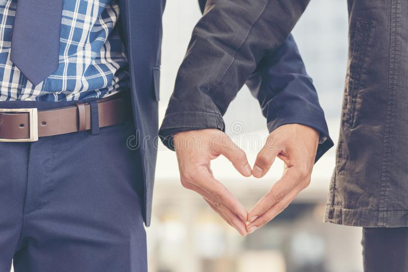 Gay in love. Couple lover. Gay couple homosexual holding hands together relation fall in love. Gay conceptual images stock photos
