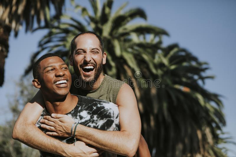 Gay couple hugging in the park stock photography