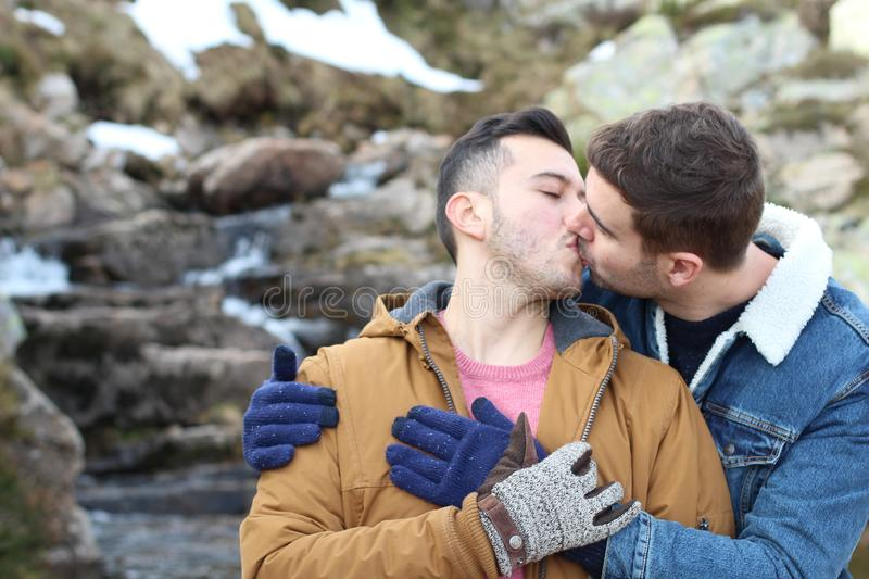 Gay couple kissing in nature royalty free stock images