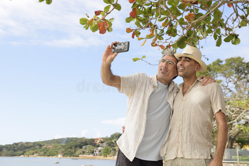 Gay couple taking a selfie with mobile phone stock photos