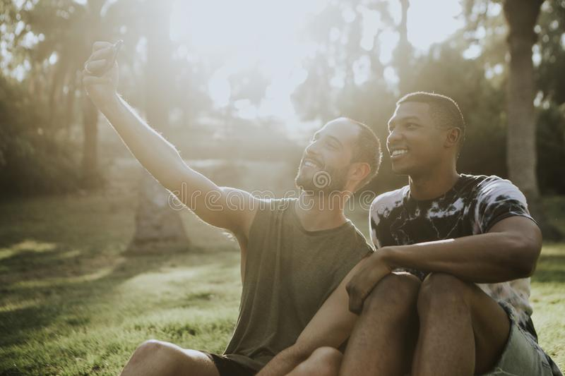 Gay couple taking a selfie in the summer royalty free stock photo