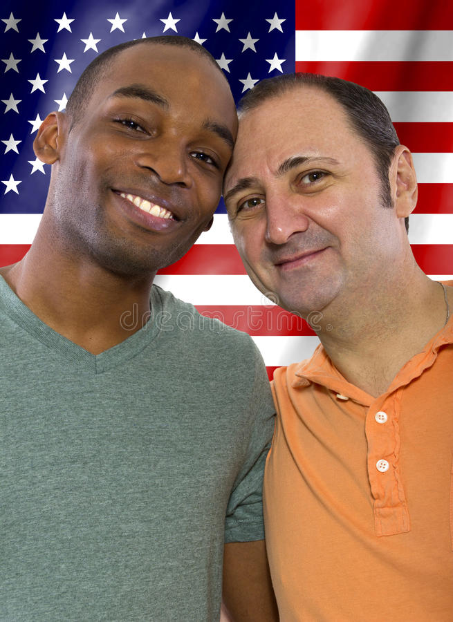 Gay Couple on 4th of July. Interracial gay couple celebrating 4th of July or American Holiday stock photos