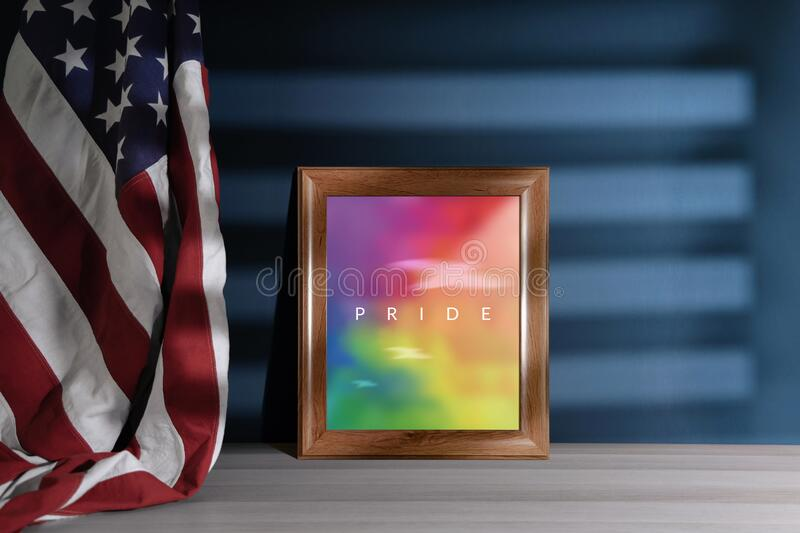 Gay, Homosexual, LGBTQ in USA Concept. Rainbow Color picture with Pride Text in Photo Frame. United States of America Flag. Hanging on the Wall royalty free stock photos