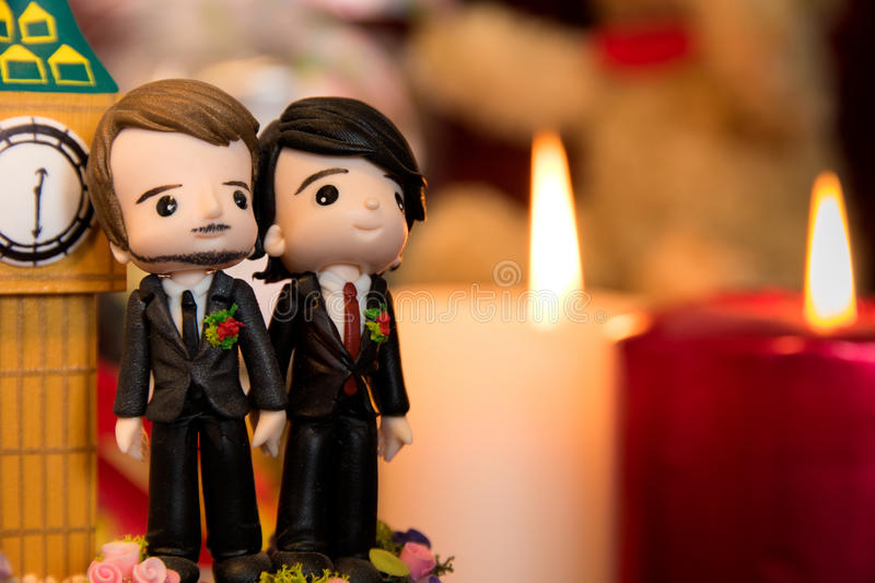 Gay Marriage. Homosexuality, same-sex marriage with two groom figurines and love concept royalty free stock photos