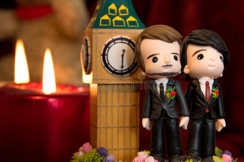 Gay Marriage. Homosexuality, same-sex marriage with two groom figurines and love concept stock image