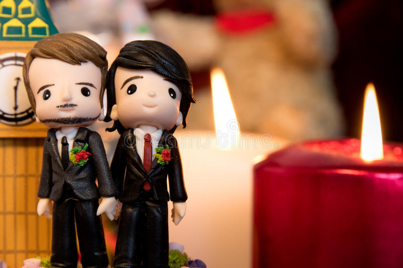 Gay Marriage. Homosexuality, same-sex marriage with two groom figurines and love concept royalty free stock photography