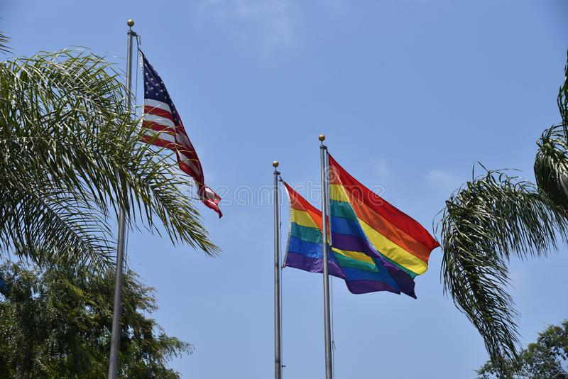 Gay pride flags. Flying near the United States flag in Los Angeles royalty free stock images