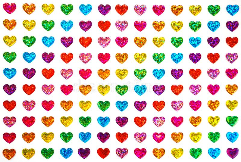 Gay pride, omosessuale, San Valentino e concetto del lgbt - cuori a colori della bandiera del fondo sessuale di minoranze come ca immagine stock