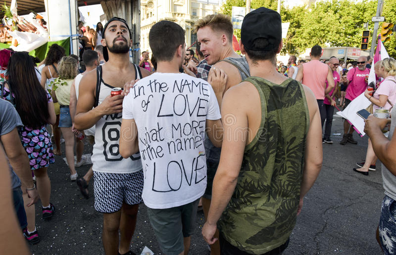 Gay pride parade in Barcelona, Spain. BARCELONA, SPAIN - JULY 8, 2017: People taking part in the gay pride parade in Barcelona, Spain, running by the famous royalty free stock photos