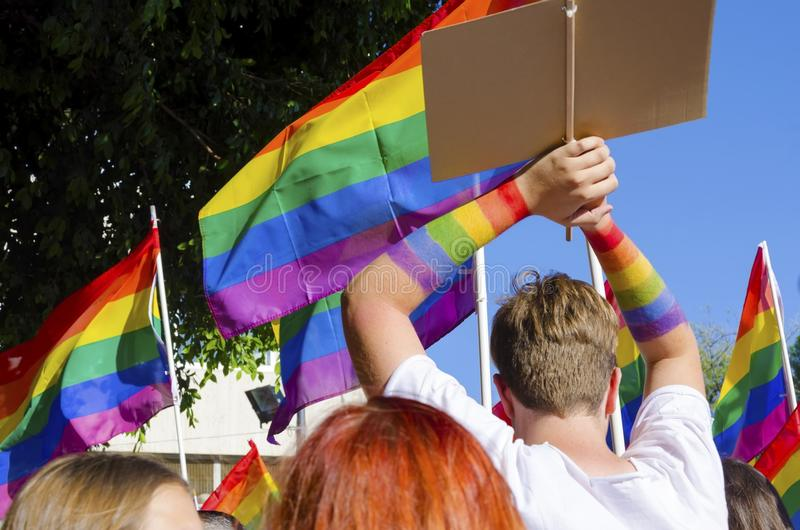 Gay Pride Parade. The first Gay Pride Parade in Cyprus to celebrate LGBT, lesbian, gay, bisexual and transgender rights. A man with rainbow colored hands raised stock images
