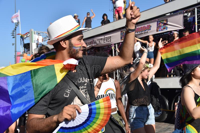 Gay Pride Parade in Marseille. Marseille, France - July 07, 2018 : Revelers take part in the Pride Parade 2018 in Marseille, southern France royalty free stock image