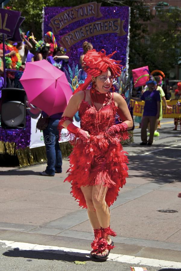 Gay Pride Participant In Bright Red Costume