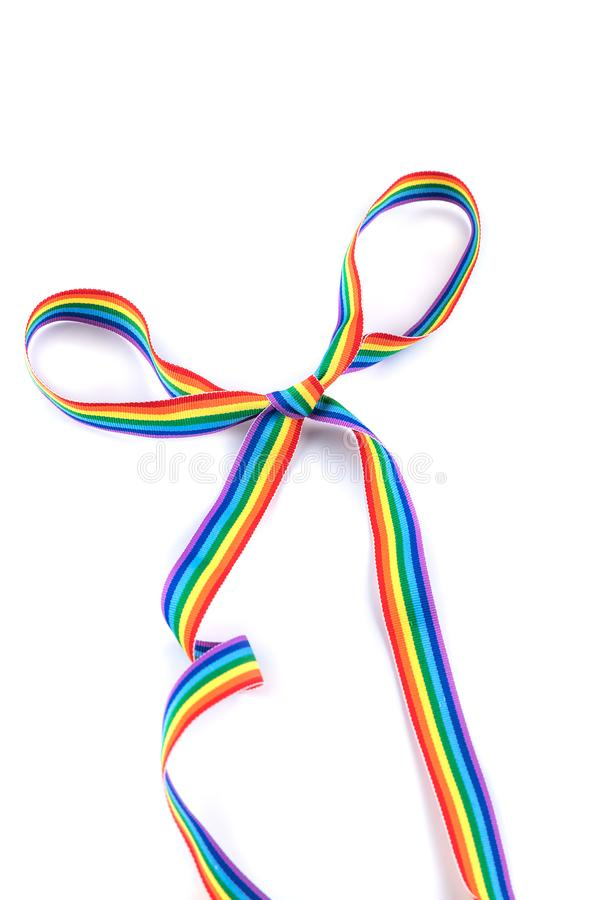 Gay pride rainbow ribbon as a bow tie isolated on white background. LGBT minimal concept royalty free stock photos