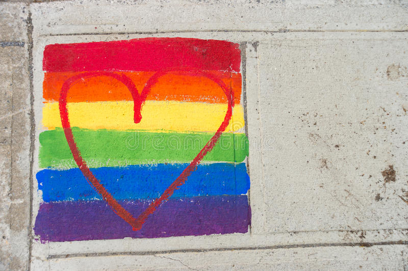 Gay rainbow flag and red heart royalty free stock images