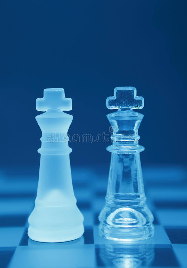 Gay marriage. Gay / same sex marriage depicted by two blue crystal King chess pieces on a board, supporting concept royalty free stock photos