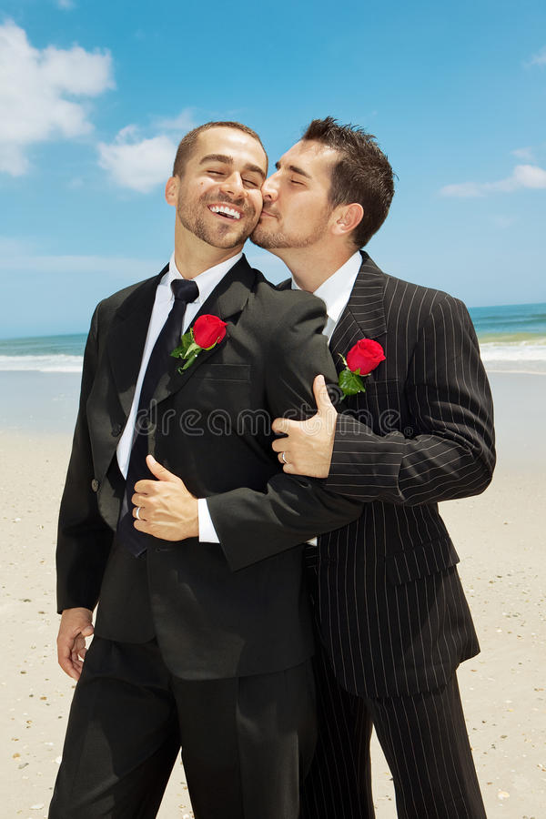 Gay wedding. Two gay men at the beach after wedding