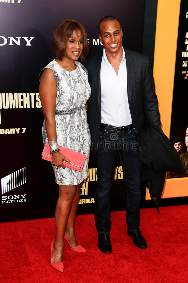 Gayle King, Will King. NEW YORK-FEB 4: TV anchor Gayle King and son Will King attend the premiere of 'The Monuments Men' at the Ziegfeld Theatre on February 4 royalty free stock photo