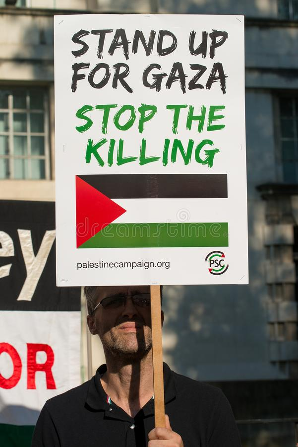 Gaza: Houd de verzameling van het Slachtingsprotest in Whitehall, Londen, het UK tegen stock fotografie