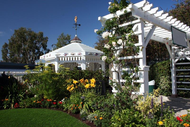 Gazebo and arch in lush garden