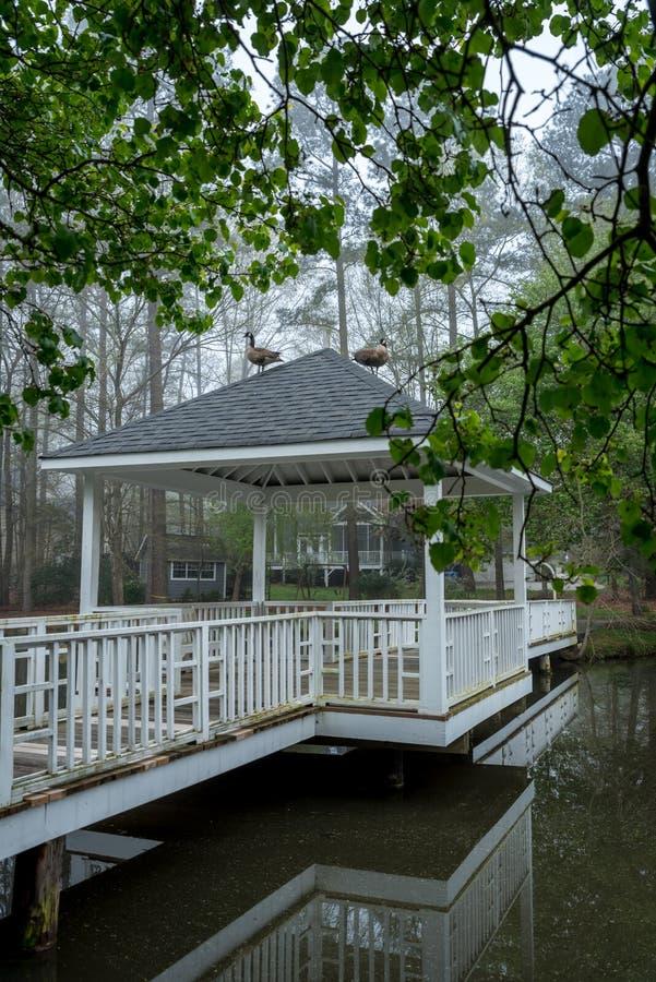 Gazebo on bridge going over pond royalty free stock photos