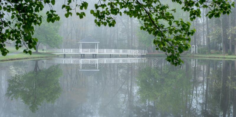 Gazebo on bridge going over pond stock photography