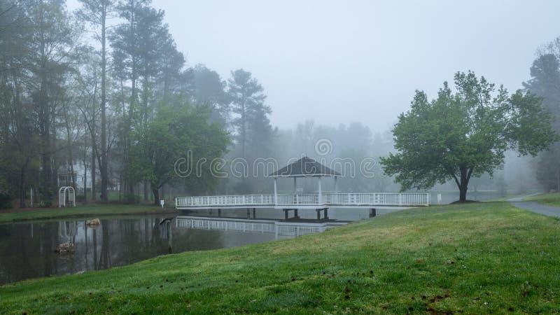 Gazebo on bridge going over pond stock images