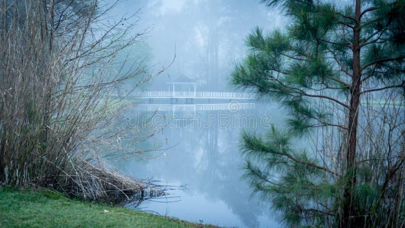 Gazebo on bridge going over pond royalty free stock photo