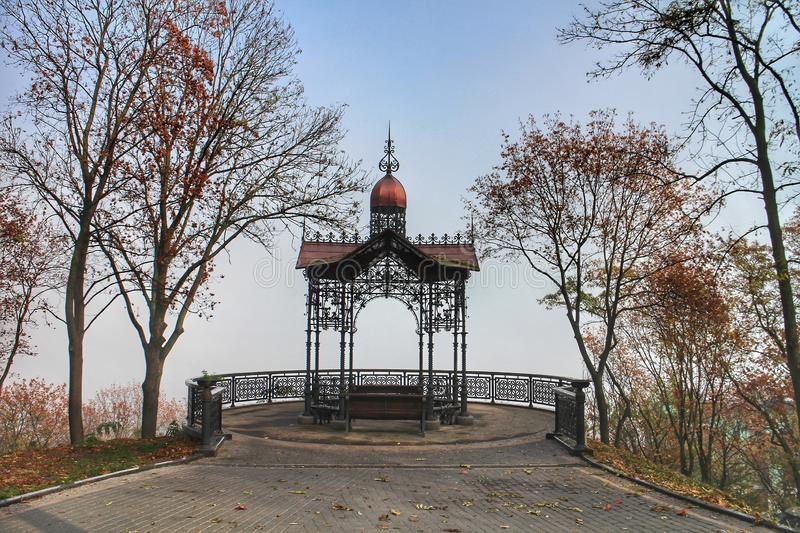A gazebo on a misty autumn day in the Volodymyrska Hill park in Kiev, Ukraine. Autumn-leaves, tranquil, pavilion, morning, capitals, autumn-park, autumn-walk royalty free stock photography