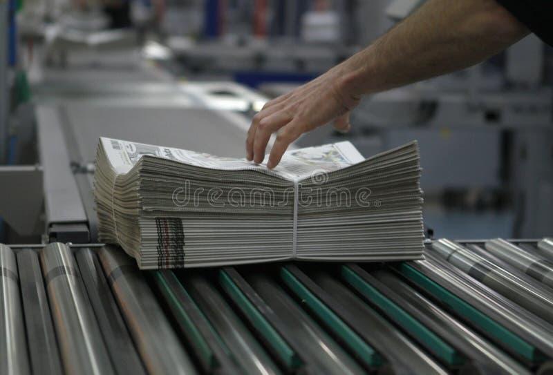 Gazety dystrybucja i pakować fotografia stock