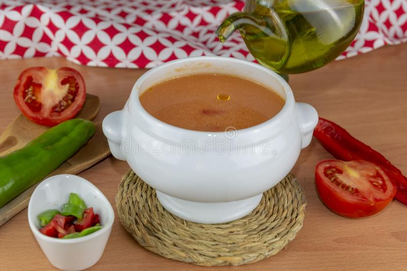 Spanish style soup made from tomatoes and other vegetables and spices, served cold royalty free stock photo