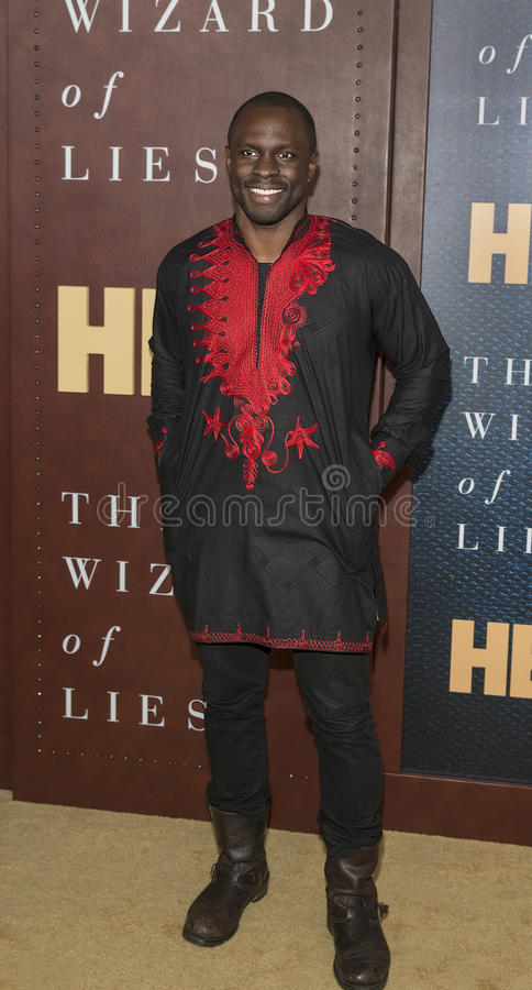 Gbenga Akinnagbe. DC native and son of Nigerian immigrants, actor Gbenga Akinnagbe arrives for the New York City premiere of `The Wizard of Lies,` at the royalty free stock image