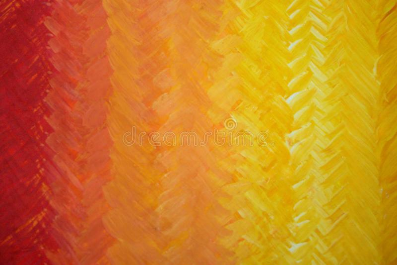 Gdaddientny background with visible brush strokes. Brush strokes form herringbone pattern. A beautiful smooth transition from red to yellow and back stock photos