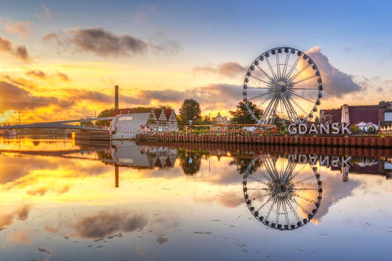 Gdansk with beautiful old town over Motlawa river at sunrise, Poland. Sign, ferris, wheel, city, symbol, text, europe, street, park, island, logo, olowianka stock photography