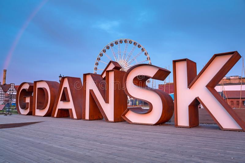 Gdansk city outdoor sign with rainbow at Olowianka island, Poland. Ferris, wheel, symbol, text, europe, street, park, logo, sky, travel, river, motlawa, old royalty free stock photo
