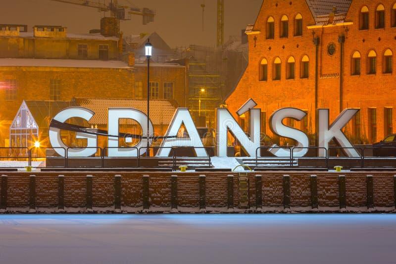 Gdansk city outdoor sign at snowy winter, Poland. Ferris wheel symbol text europe street park island olowianka sky travel river motlawa beautiful town polish royalty free stock image