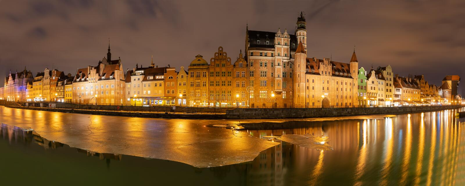 Gdansk evening panorama with medieval gates and Old Town facades on the bank of the Motlawa river.  stock photos