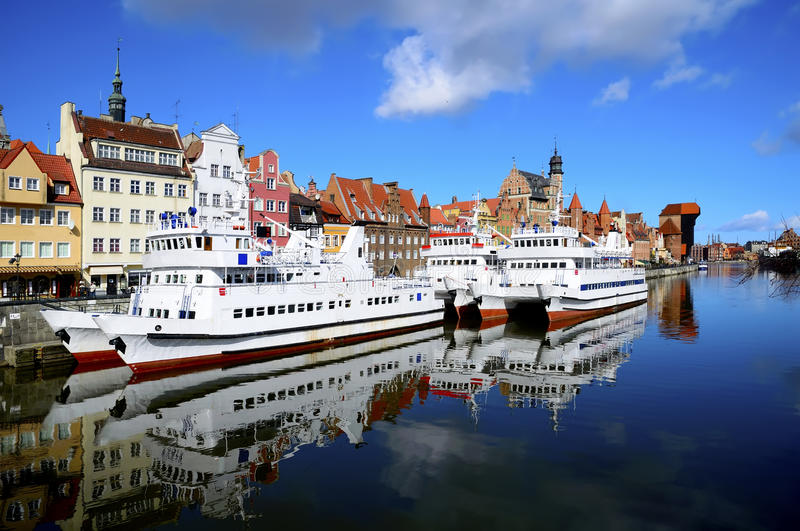 Gdansk harbor, poland. Ships in harbor and historic city of gdansk (danzig) in poland stock photography