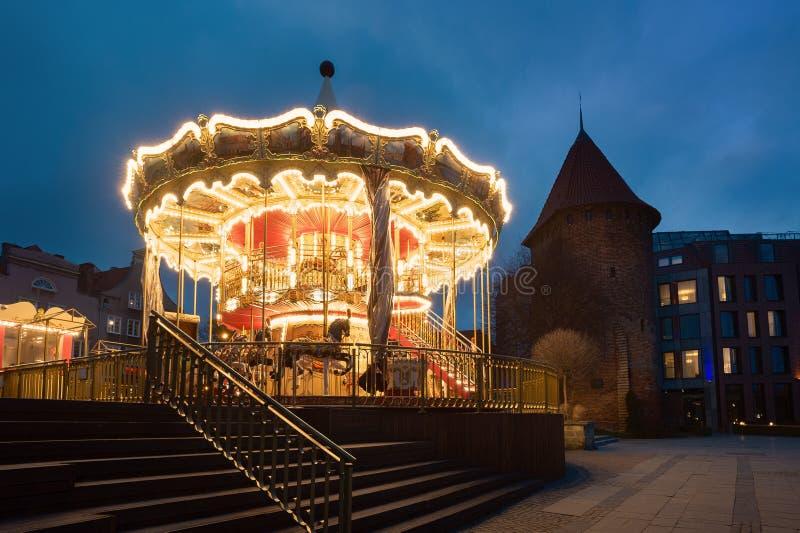Gdansk karusell i aftonen fotografering för bildbyråer