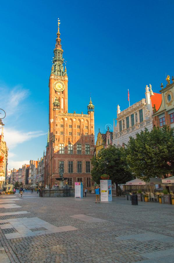 City Hall and historic Neptune`s Fountain at Long Market street in the morning in Gdansk, Poland royalty free stock images