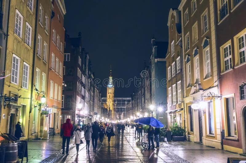 GDANSK, POLAND - DECEMBER 3, 2016: People walk along the Long Street Dluga in Gdansk old town, Poland. Tower of Gdansk Town Hall stock images