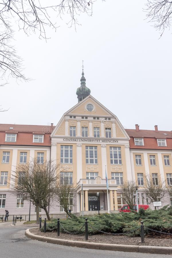 The historic Building 1 of the Medical University of Gdansk Hospital at cloudly day. Gdansk, Poland - February 17, 2019: The historic Building 1 of the Medical stock photography