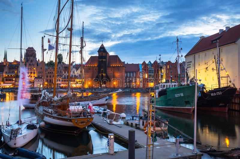 Gdansk, Poland - July 8, 2019: Beautiful scenery of Gdansk over Motlawa river at dusk, Poland. Gdansk is the historical capital of. Polish Pomerania with royalty free stock image