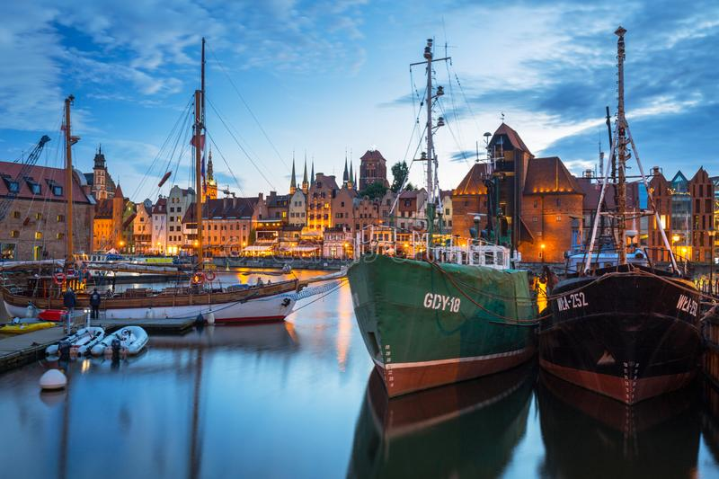 Gdansk, Poland - July 8, 2019: Beautiful scenery of Gdansk over Motlawa river at dusk, Poland. Gdansk is the historical capital of. Polish Pomerania with stock images