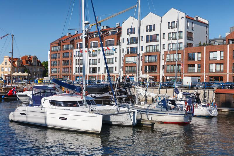 GDANSK, POLAND - May 21, 2018: White yachts parked in water city channel stock photos