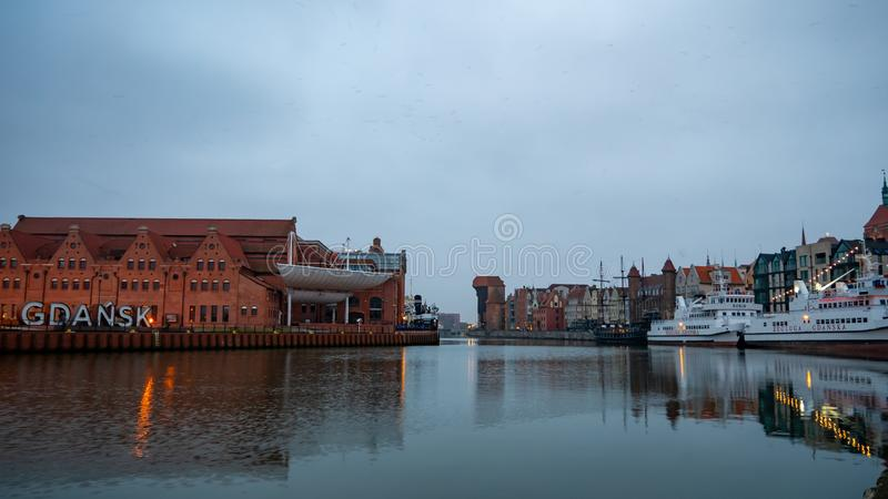 Panorama of the riverside in Gdansk. Clouds over the city. stock photos