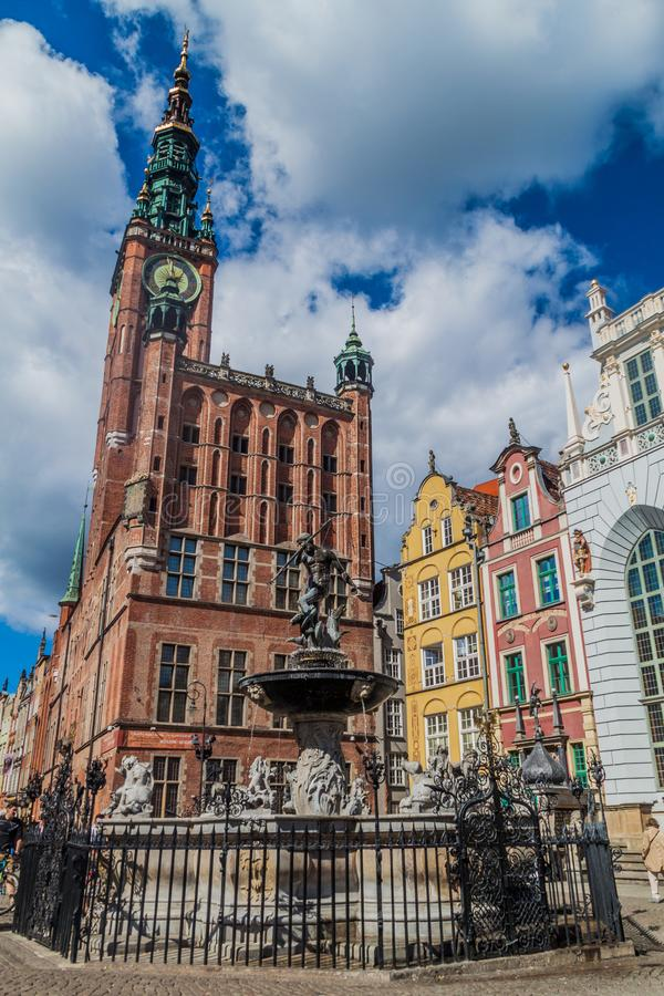 GDANSK, POLAND - SEPTEMBER 2, 2016: Neptune`s fountain and the Town hall in Gdansk, Pola royalty free stock photography